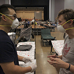 """Alums, students take on """"back-breaking"""" work at wildfire evacuation center"""